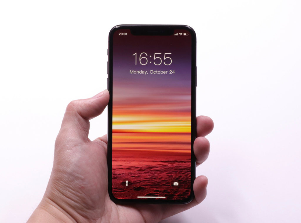 smartphone with sunset wallpaper
